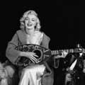 This fun, black and white photograph by Milton H Greene features Marilyn Monroe with a big smile and holding a mandolin. Taken in September, 1953 in Los Angeles for Look magazine, this was Milton and Marilyn's First Sitting.