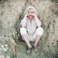 Photographed by Milton H Greene in Laurel Canyon, Los Angeles in 1953 for Look Magazine, Marilyn Monroe is sitting against a rock face and wearing pedal pusher corduroy suit. Exuding strength and self confidence while donning bright red lipstick, Marilyn's sleeves are pushed up and her arms are on her knees and supporting her face.
